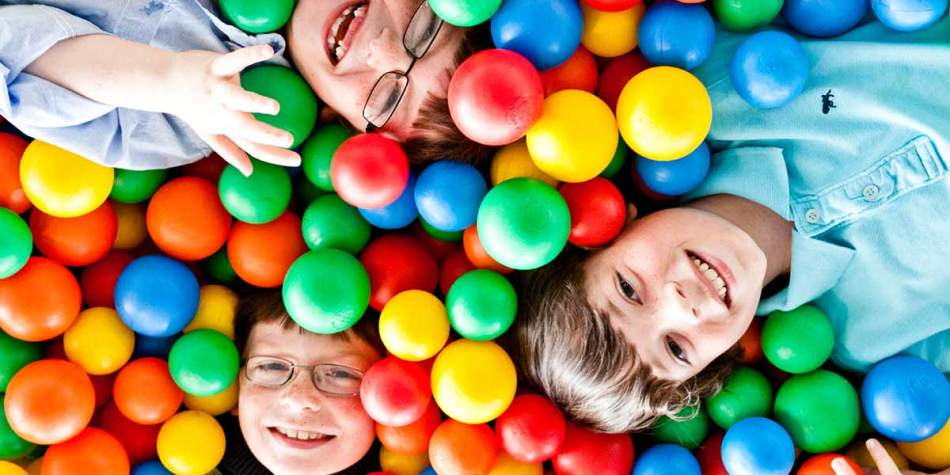 Children enjoying playing in a ball pit onboard DFDS Patria Seaways ferry