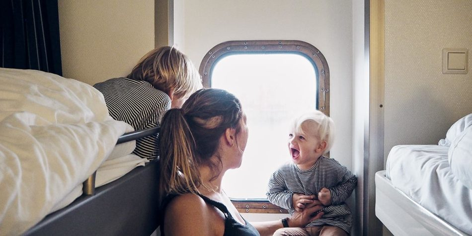 A family laughing with each other in a seaview cabin