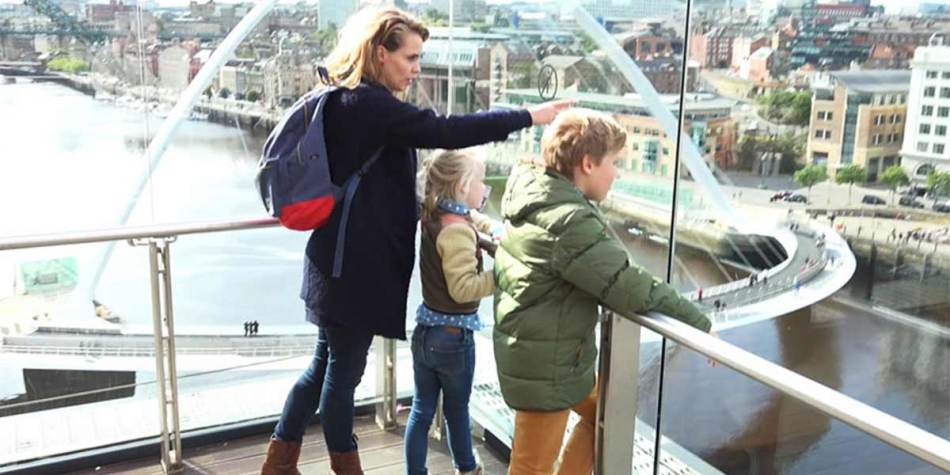 A family looking over the Millennium Bridge