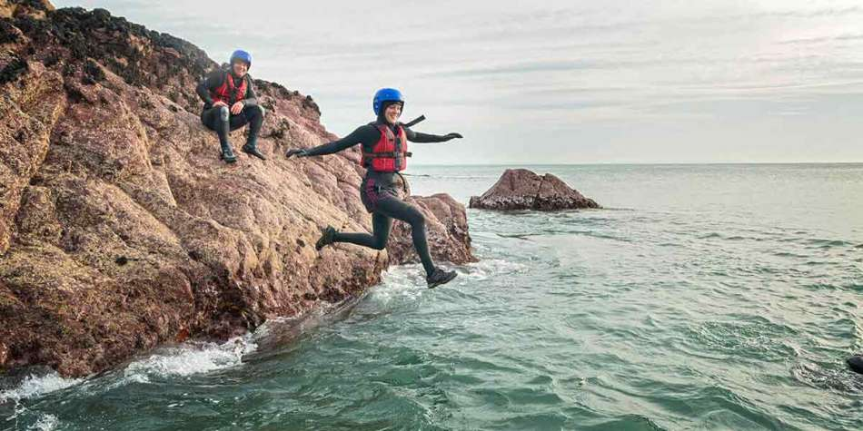 Woman taking part in coasteering