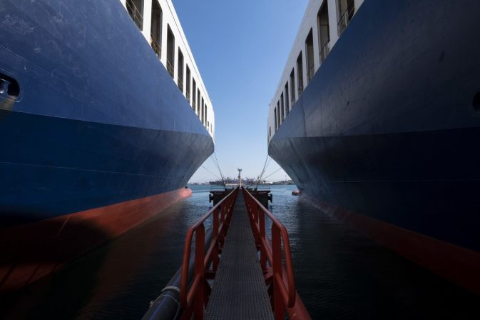 view from the middle of two DFDS Freight shipping vessels, docked side by side