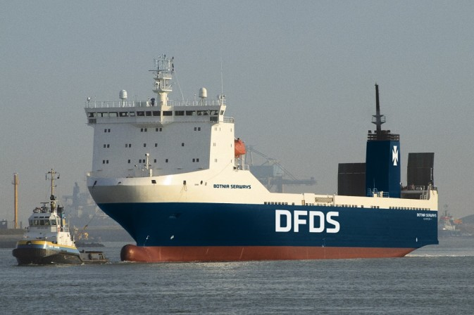 DFDS vessel Botnia Seaways being tugged though a harbour