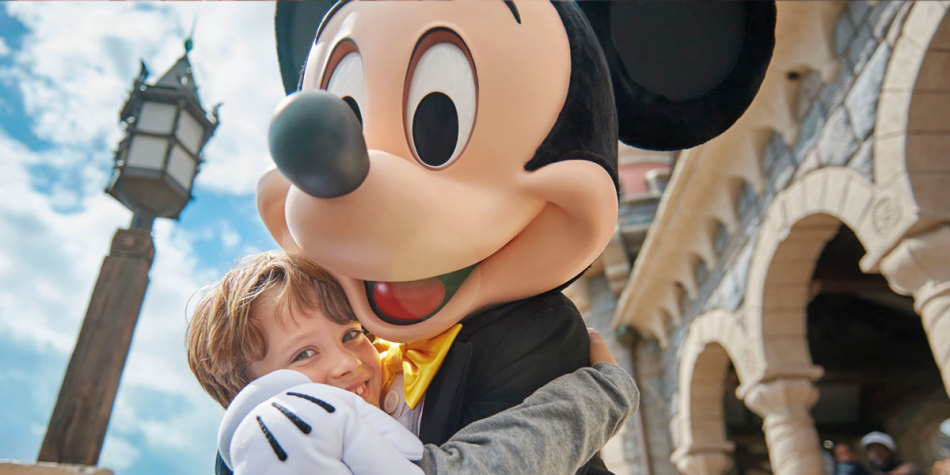 Boy at Disneyland® Paris with Mickey Mouse