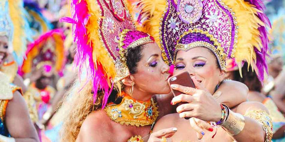 2 carnival dancers taking a selfie together