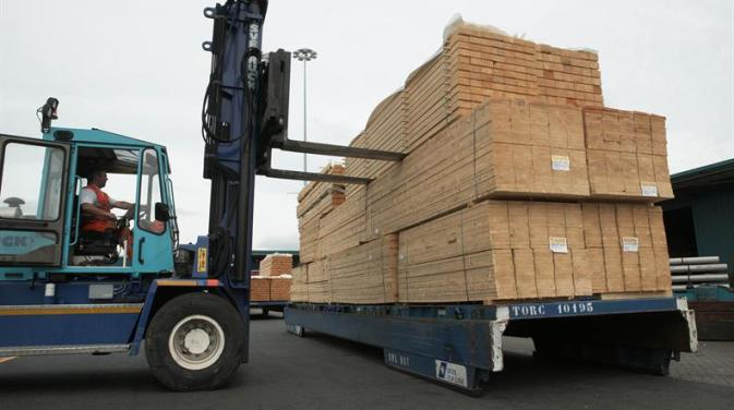 DFDS Logistics forklift carrying forest products and lumber