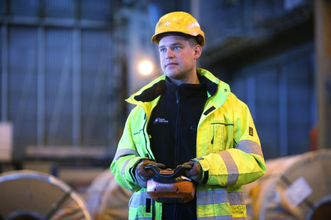 DFDS warehouse employee inspecting metal coils
