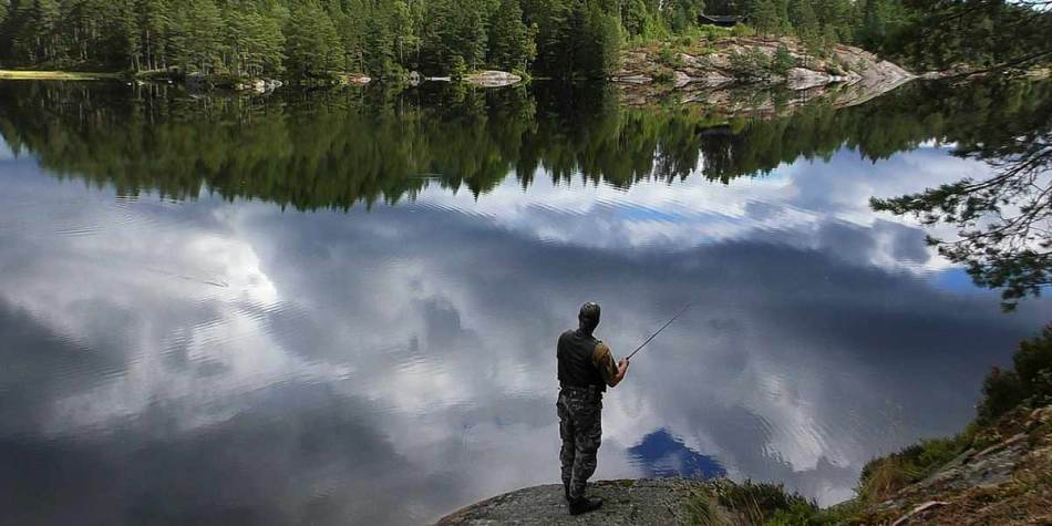 Man fishing at beautiful site in Norway