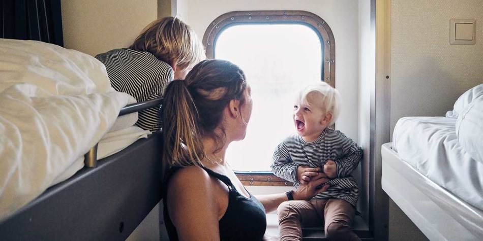 Family enjoying a DFDS sea view cabin