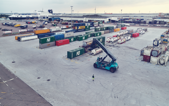 DFDS Freight forklift loading shipping containers at a terminal