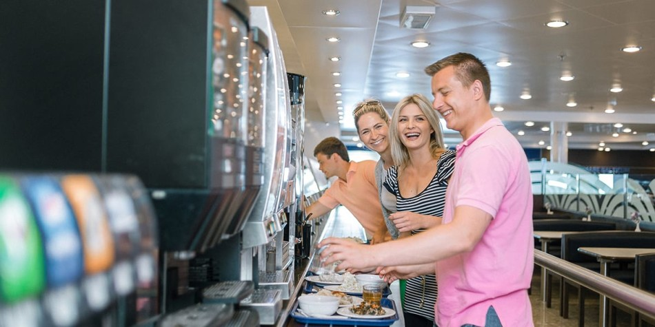 A group of people enjoying the self-service facilities at restaurant onboard Athena Seaways in the Baltics.