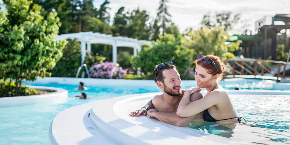 Couple relaxing in pool at Ronneby Brunnspark