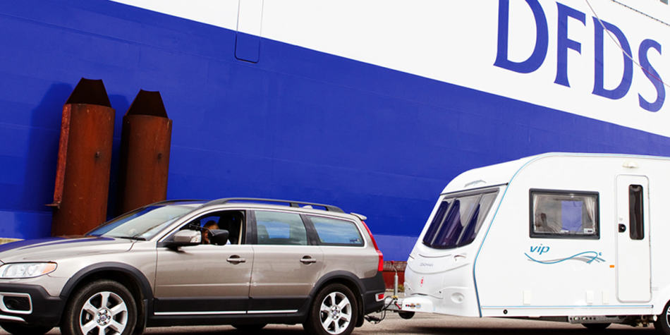 Car with caravan boarding on DFDS