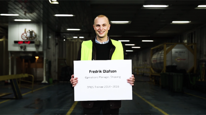 DFDS trainee Frederik Olufson standing on the car deck of a DFDS ship