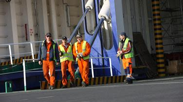 DFDS stevedores walking by an open loading ramp