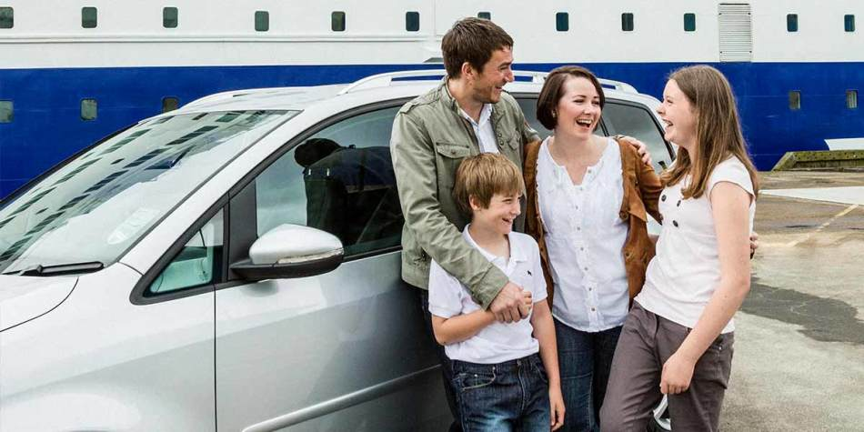 Family in car travelling on Ferry