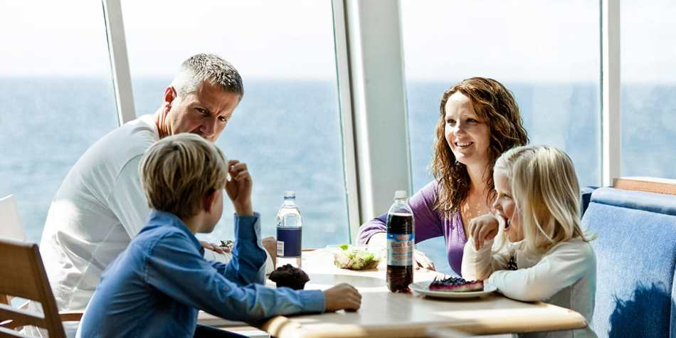 Family of four having a meal at 7 Seas restaurant onboard Eastern Channel Ferry.