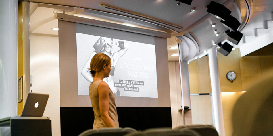 An onboard conference being projected onto a screen.