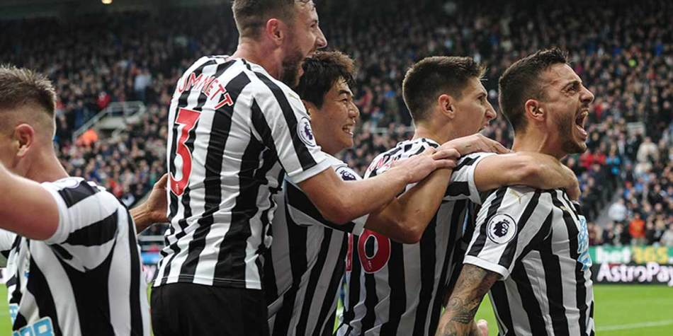 Players celebrating at St James Park, Newcastle
