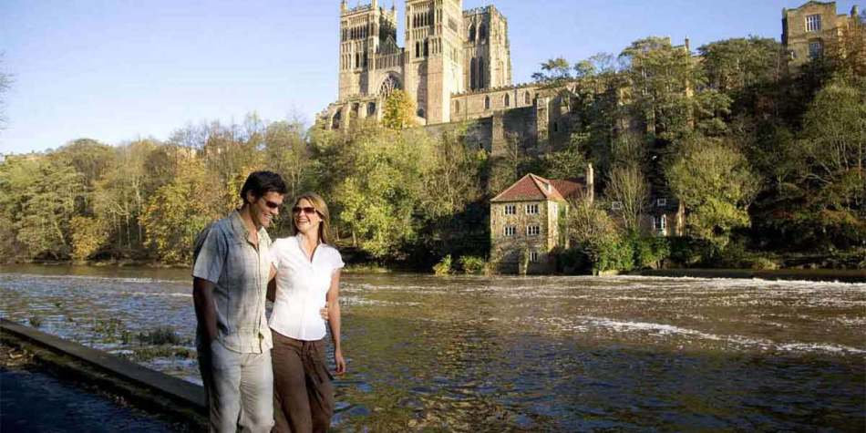 Couple on the river bank in Durham