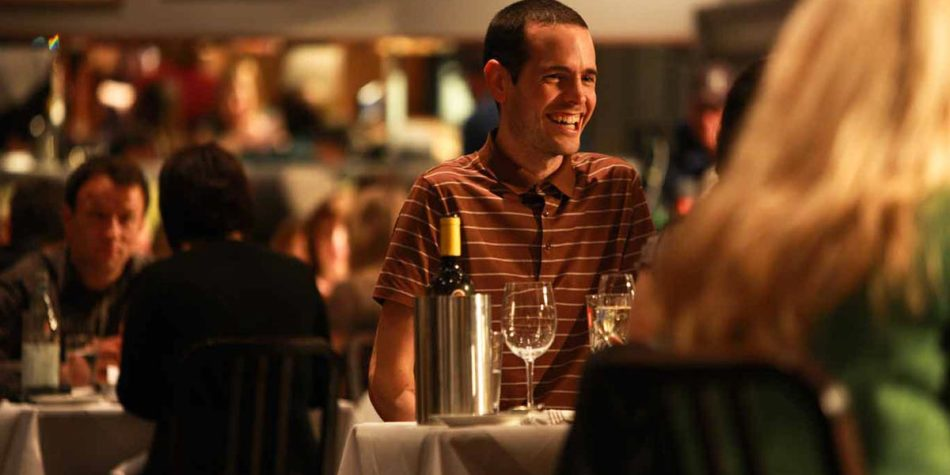 Man enjoying wine in a restaurant