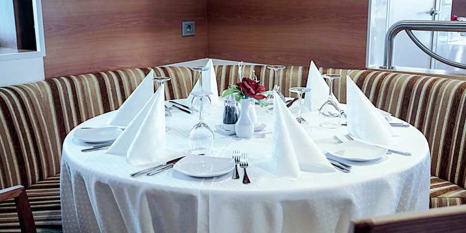 A group table set a la carte for customer in restaurant onboard Liverpool Seaways in the Baltics.