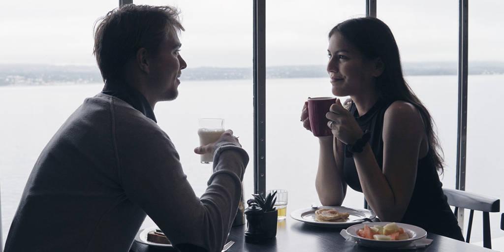Couple having breakfast on board