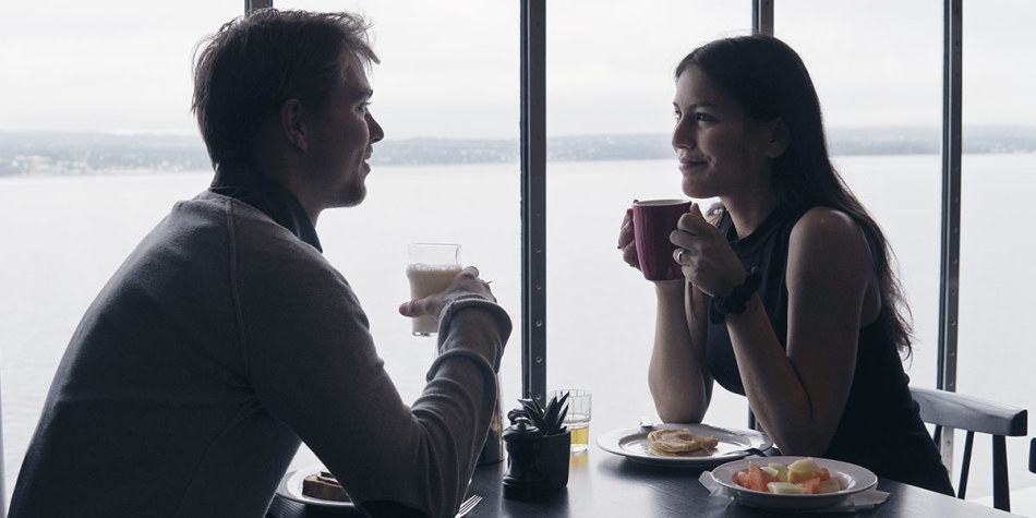 Couple having breakfast on board