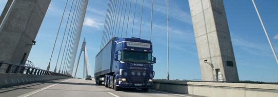 A DFDS Logistics truck crossing a bridge