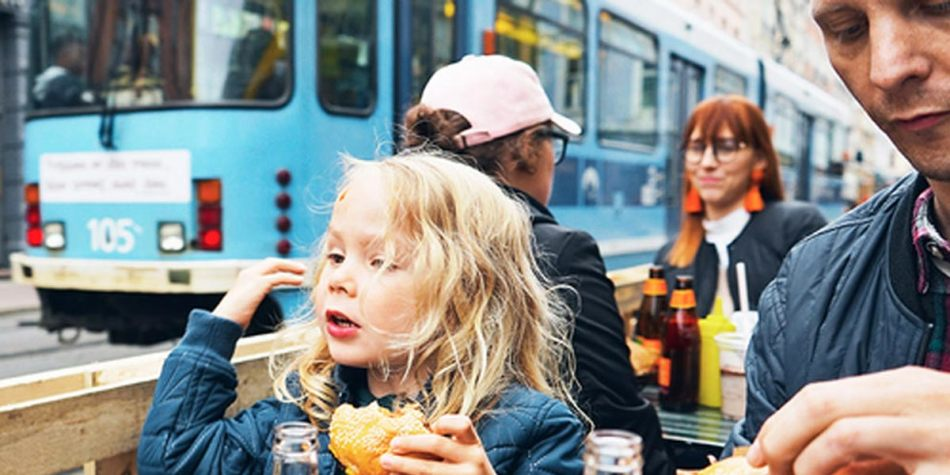Young girl enjoying food in Oslo