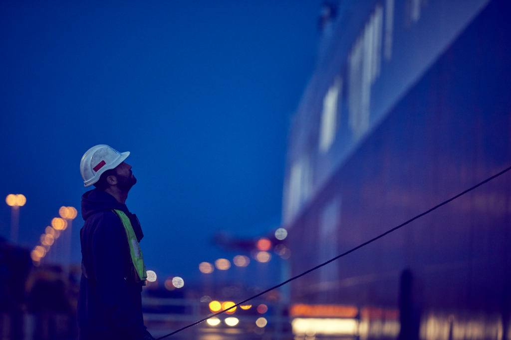 DFDS employee looking up at night time