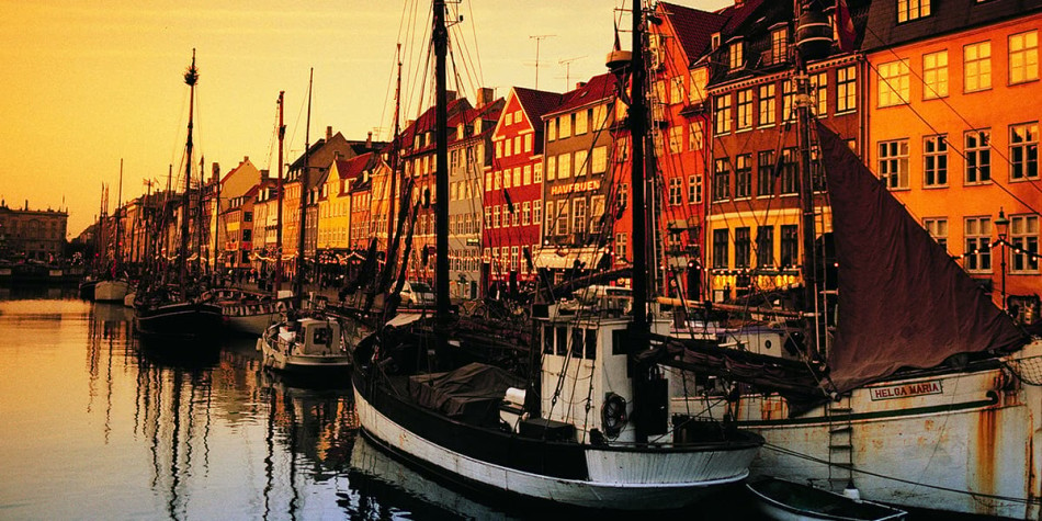 The nyhavn waterfront in Copenhagen at sunset.
