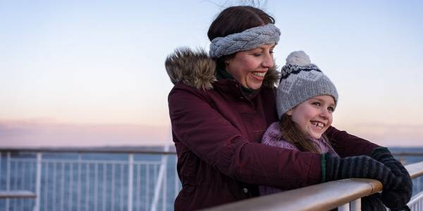 Mother and daughter on deck in winter