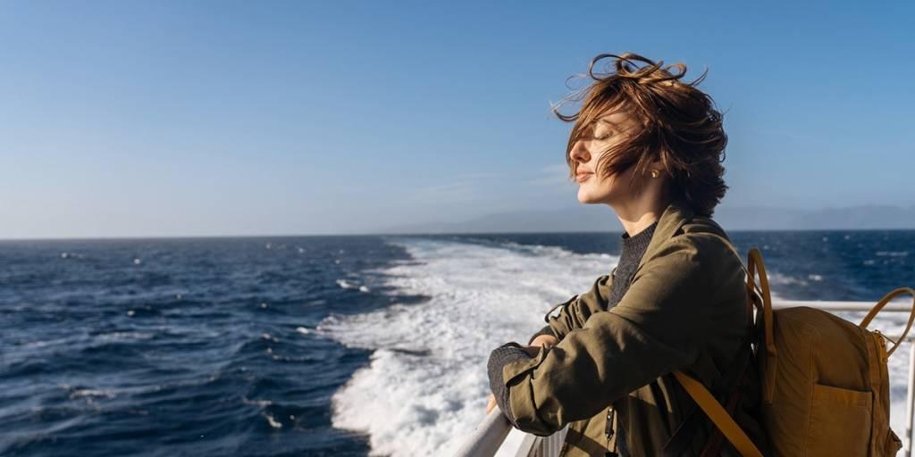 Woman enjoying fresh air on deck