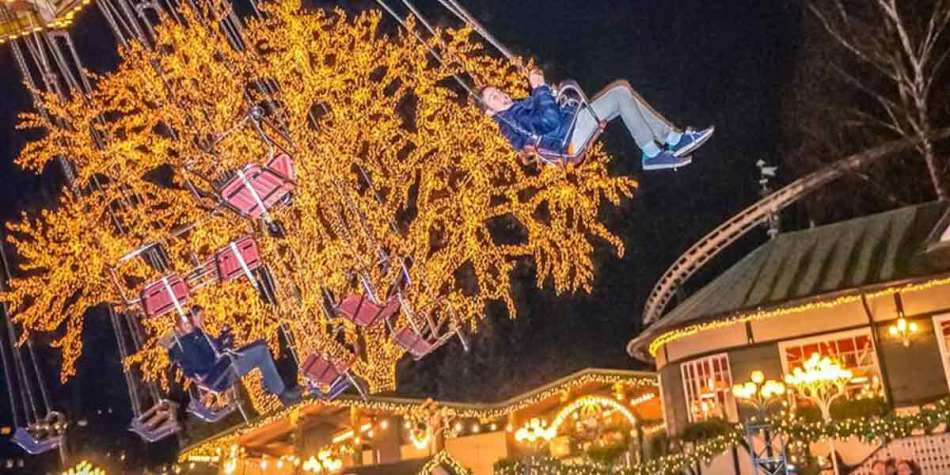 People enjoying the rides at Liseberg Park, Gothenburg at Christmas