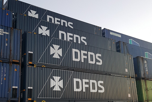 DFDS Freight Shipping containers stacked in a shipyard