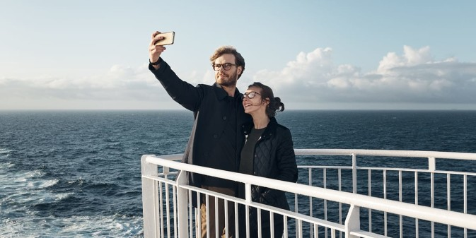 Couple on deck onboard DFDS ferry taking a selfie