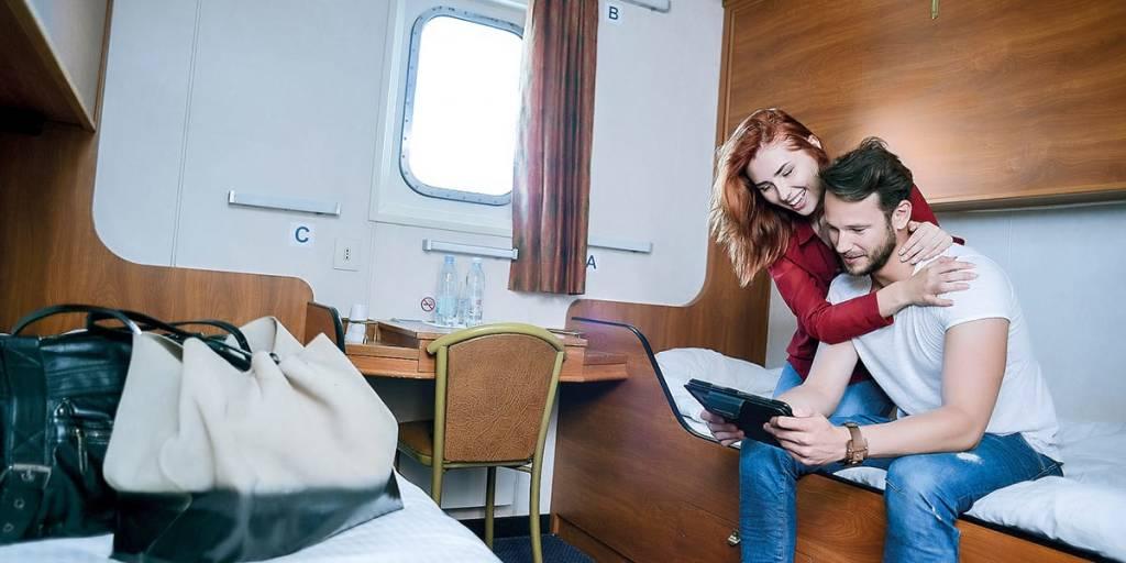 Couple in cabin onboard Kiel-Klaipeda
