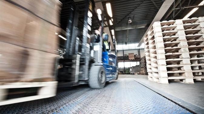 DFDS forklift stacking empty pallets