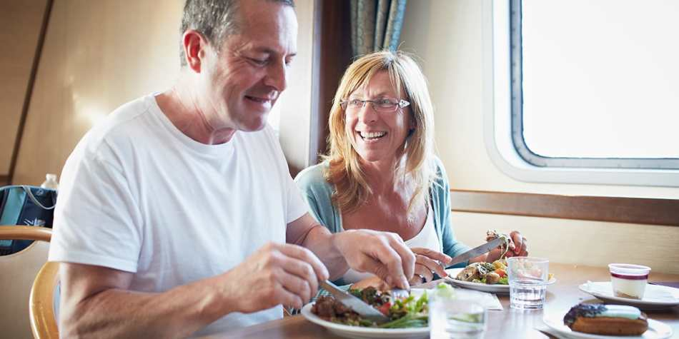Couple enjoying food in a restaurant onboard DFDS Newhaven- Dieppe ferry.