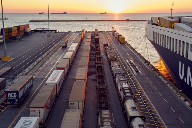 Trailers lined up beside a vessel at the DFDS Freight shipping terminal in Trieste