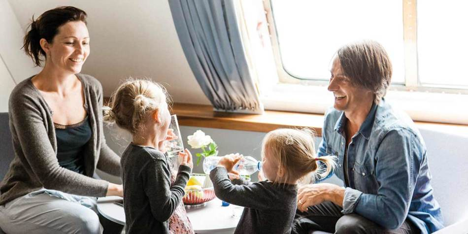 A family laughing together in onboard cabin