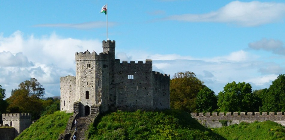 Castle in Cardiff with blue sky and green nature