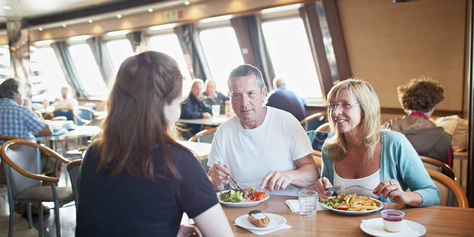People enjoying food in a restaurant onboard DFDS Newhaven- Dieppe ferry.