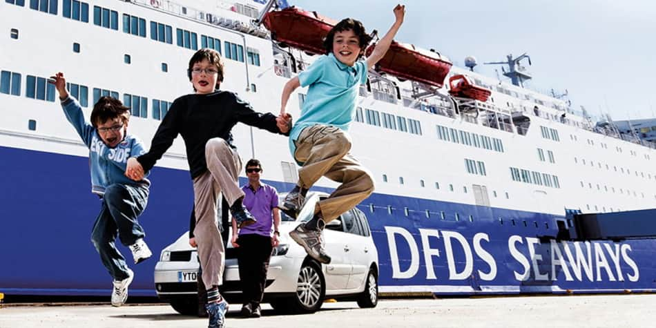 Children jumping outside a DFDS ship