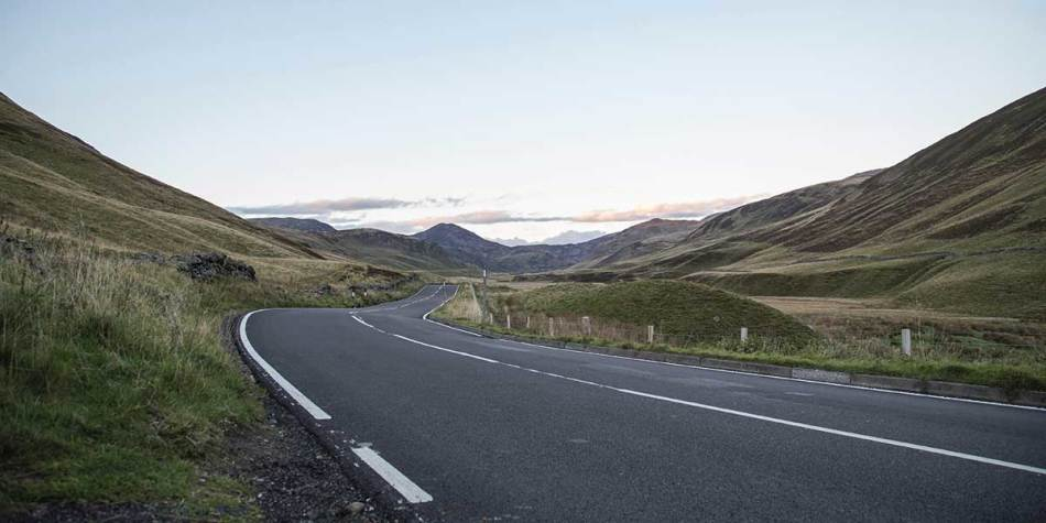 Open road in the mountains in Cairngorms National Park