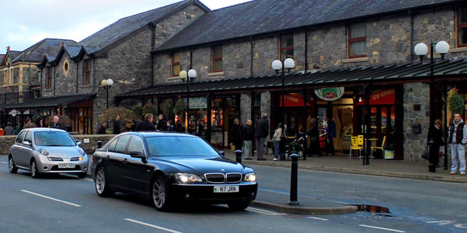 Cars on street in Betws city centre Wales