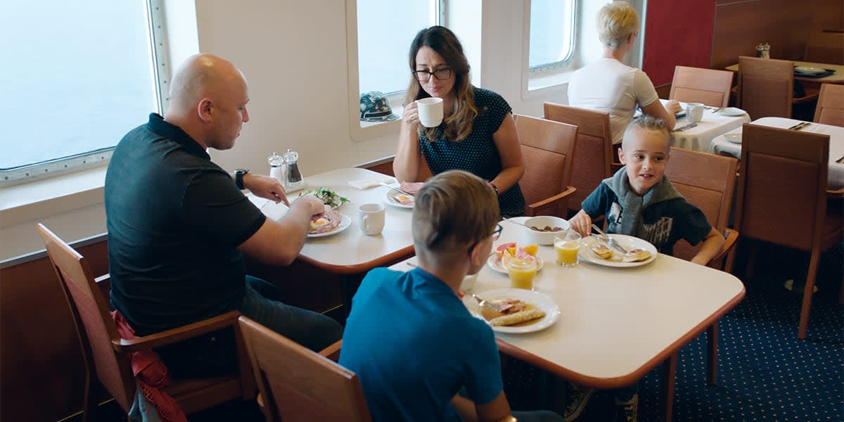 Family in self-service restaurant, Klaipeda-Kiel