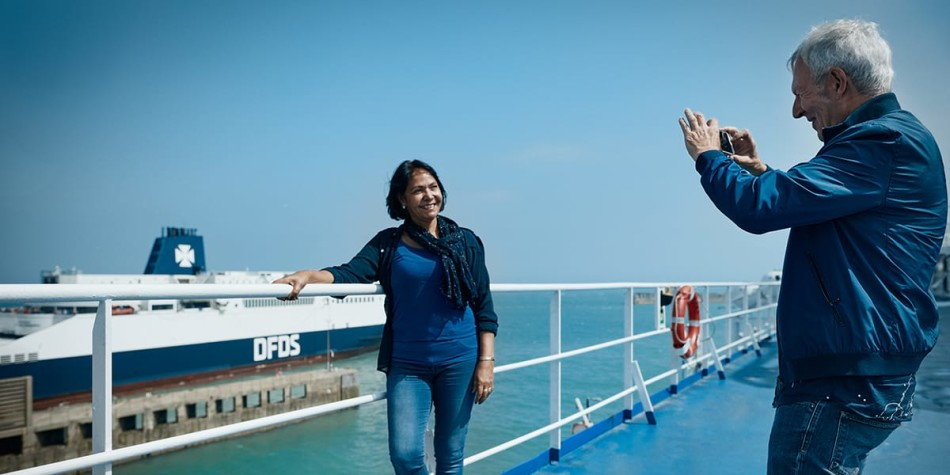 Elder couple taking a picture on deck onboard Eastern Channel Ferry.