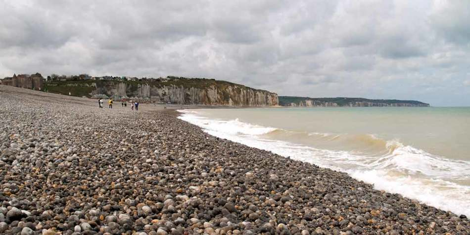 A stone beach in Dieppe on a cloudy day