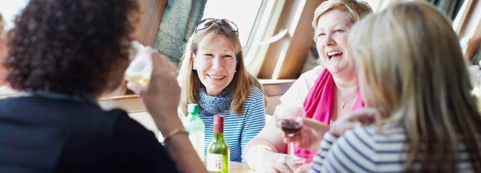 Women eating and drinking onboard Dieppe-Newhaven ferry
